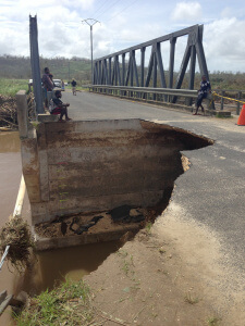: Initial reports suggested infrastructure was badly damaged. This broken bridge, outside Port Vila, shows that access to nearby affected areas is compromised. Photo credit: UNICEF Pacific